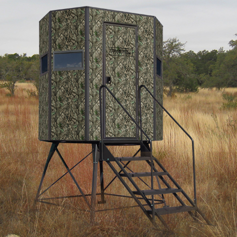 A Texas Hunter Products brand hunting stand set up in a field